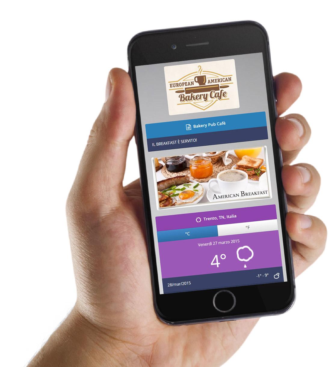 Una mano mostra un cellulare smartphone con visualizzata la pagina di benvenuto (Guest Portal) dii un hotspot wifi WiSpot.
