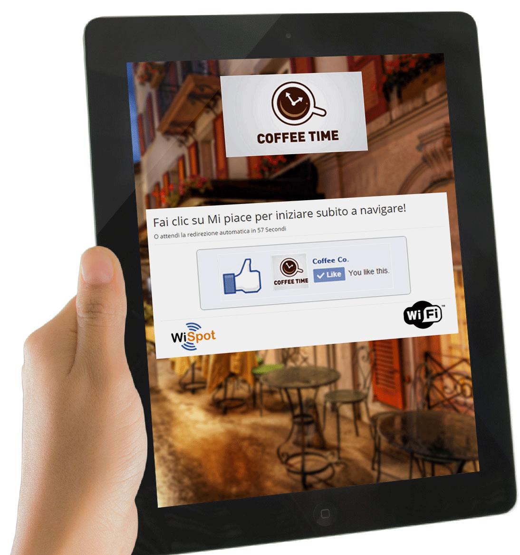 Una mano regge un tablet sul quale è visualizzata la schermata di accesso al social wifi hotspot di WISpot.