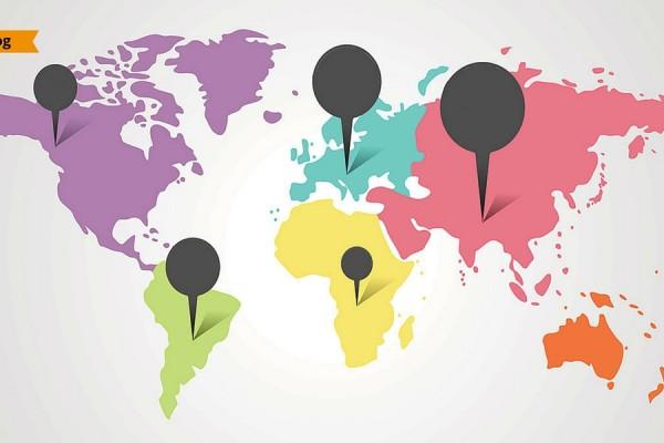 Una cartina colorata della terra, con dei segnaposto fissati su ogni continente.
