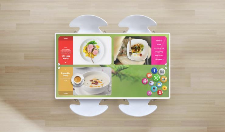 Un tavolo da consumazione per ristorante dotato di schermo digitale su cui sono visualizzati piatti e menù.